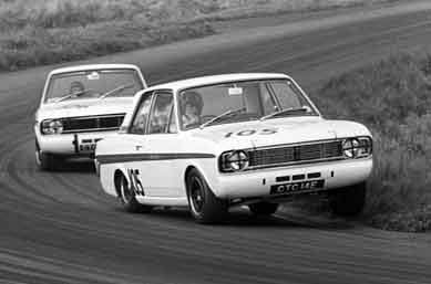 Graham Hill and Jacky Ickx in Lotus Cortinas, 1967 Gold Cup