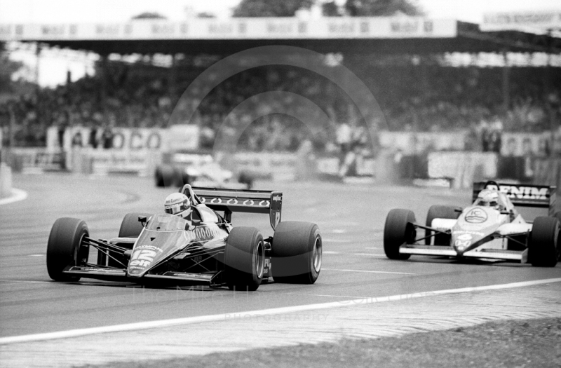 Ayrton Senna, JPS Lotus 97T, Keke Rosberg, Williams FW10, 1985 British Grand Prix, Silverstone.