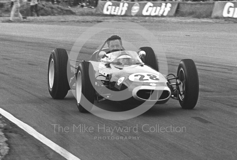 Graham Hill demonstrates his 1962 championship-winning BRM P57 V8, Silverstone, 1969 British Grand Prix.
