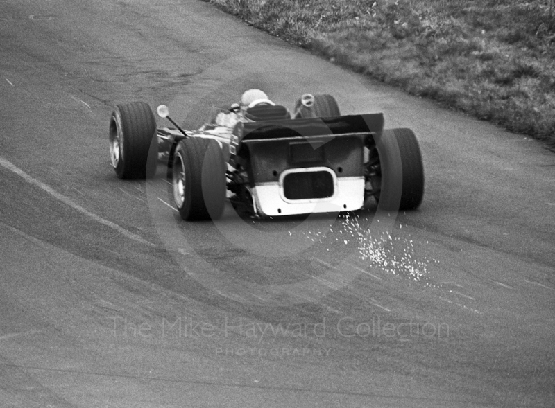 Sparks fly from beneath the Gold Leaf Team Lotus 56B turbine of Reine Wisell at Deer Leap, Oulton Park Rothmans International Trophy, 1971