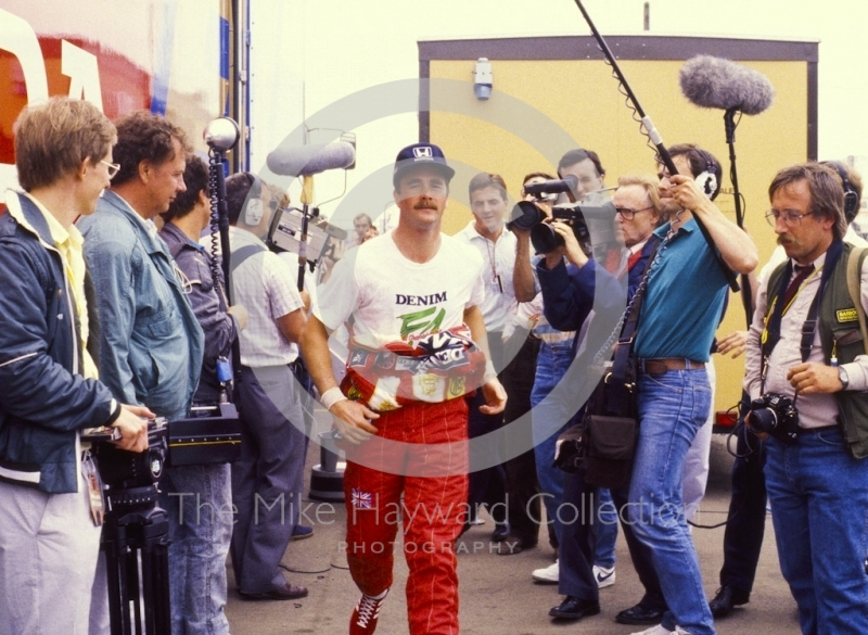 Nigel Mansell runs through the paddock, British Grand Prix, Silverstone, 1987