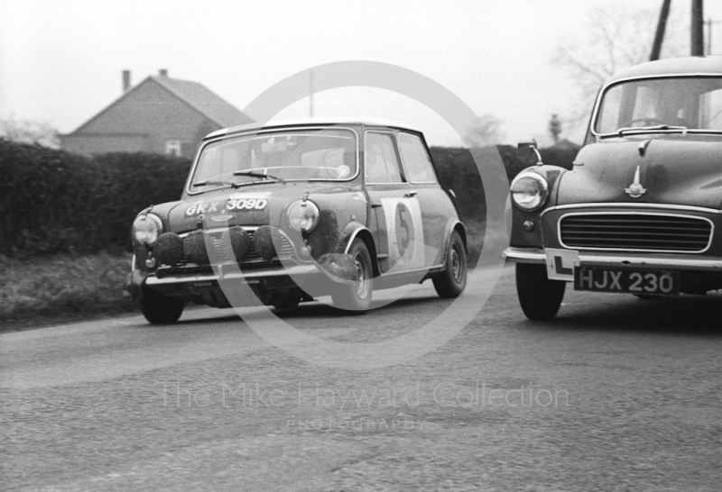 Graham Hill/Maxwell Boyd, works Mini Cooper S, reg no GRX 309D, between stages in Shropshire before retiring with broken transmission in the Lake District, RAC Rally, 1966