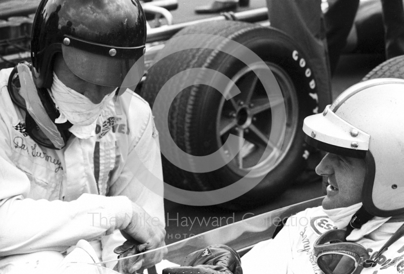 Dan Gurney, left, chats to Denny Hulme on the grid at Silverstone before the start of the 1967 British Grand Prix.
