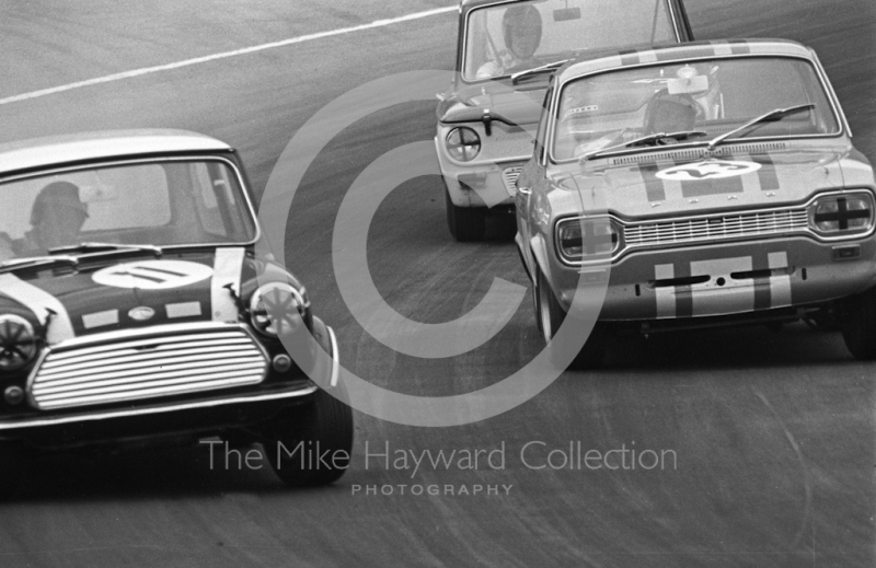 John Rhodes, Mini Cooper S, Alan Peer, Ford Escort GT, and Tony Lanfranchi, Alan Fraser Sunbeam Imp, at South Bank Bend, Brands Hatch, Grand Prix meeting 1968.