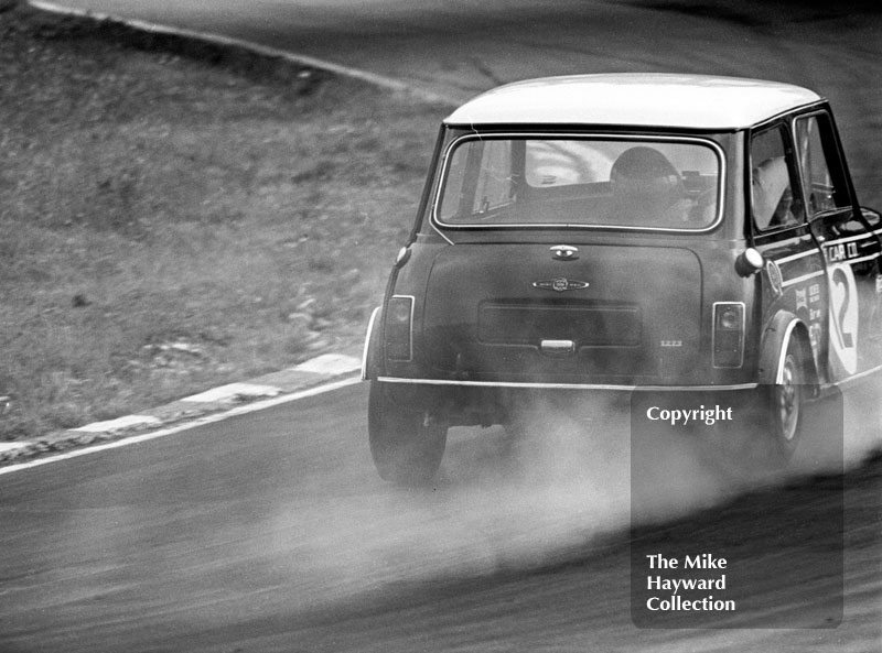 Steve Neal, Cooper Car Company Mini Cooper S, smokes around South Bank Bend, ritish Saloon Car Championship race, 1968 Grand Prix meeting, Brands Hatch.
