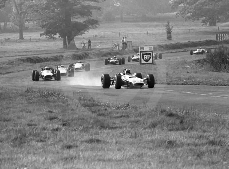 Jackie Stewart, Tyrrell Matra Ford MS7-02, leads the field into Esso Bend, Oulton Park, Guards International Gold Cup, 1967.