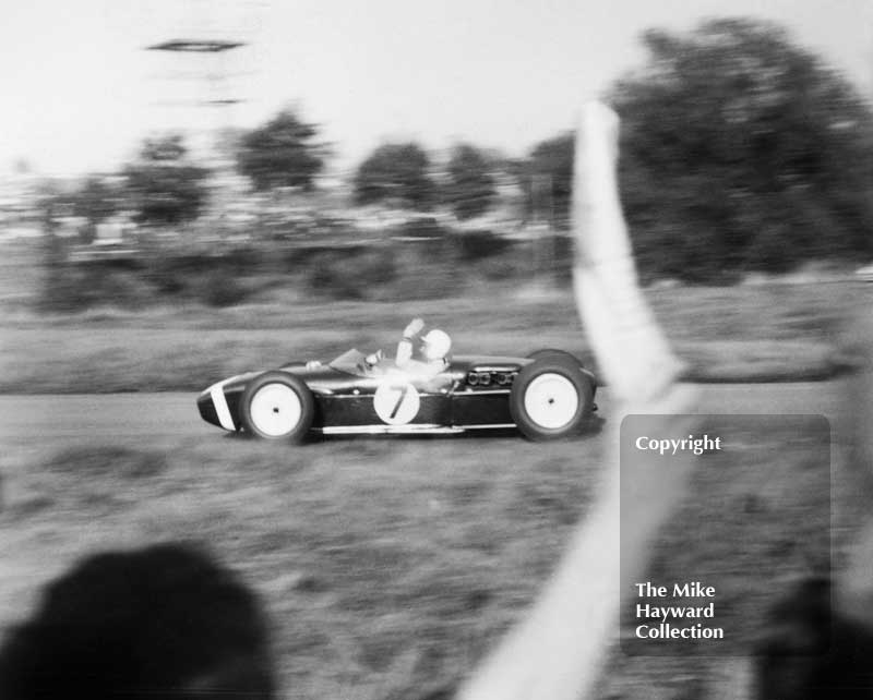 Stirling Moss, Lotus 18, on his victory lap after winning the 1960 Oulton Park Gold Cup.
