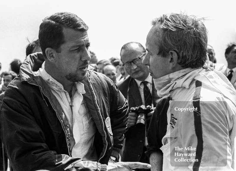 Jo Bonnier, left, chats to John Surtees on the grid at Silverstone before the start of the 1967 British Grand Prix.