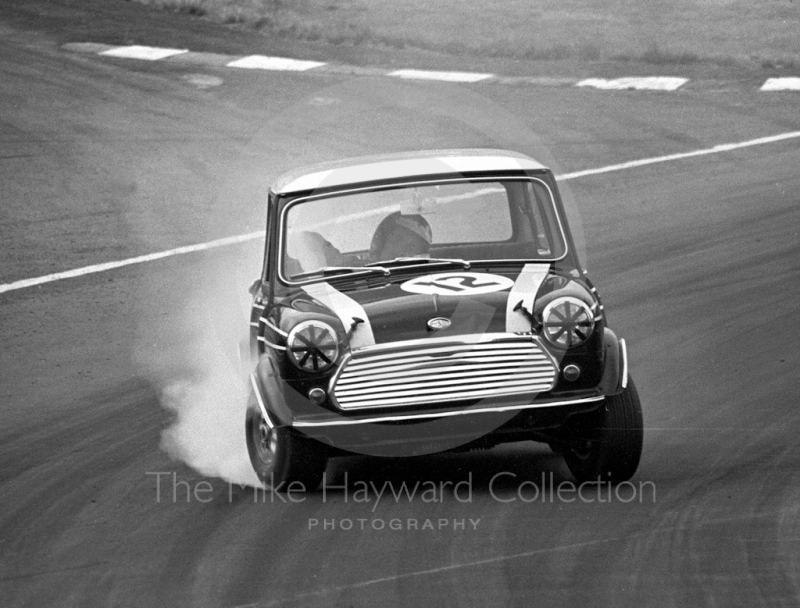 Steve Neal, Cooper Car Company Mini Cooper S, smokes through South Bank Bend, Brands Hatch, Grand Prix meeting 1968.