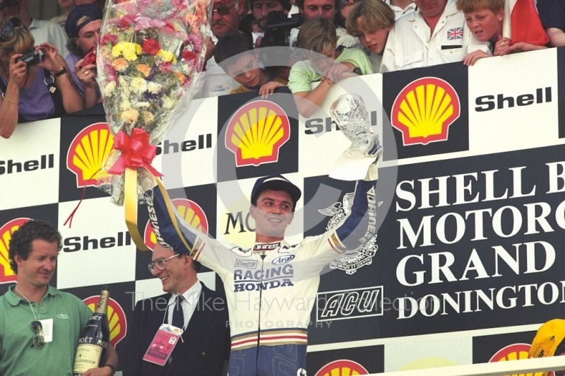 Luca Cadalora celebrates winning the 250cc Grand Prix, Donington Park, British Grand Prix 1991.