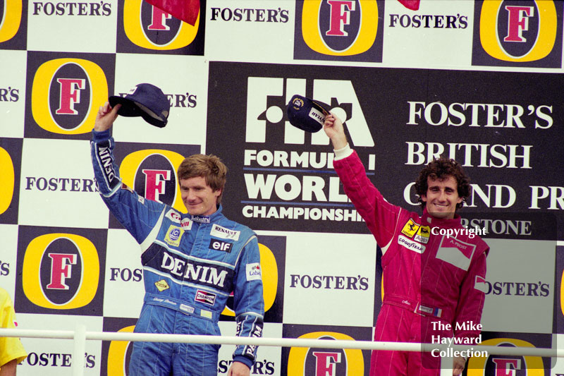 Thierry Boutsen and race winner Alain Prost on the podium at Silverstone, 1990 British Grand Prix.
