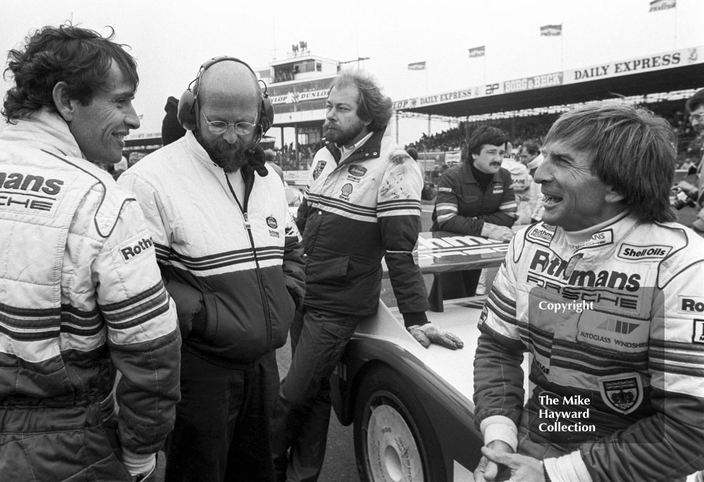 Rothmans Porsche drivers Derek Bell and Jacky Ickx on the grid, World Endurance Championship, 1985 Grand Prix International 1000km meeting, Silverstone.