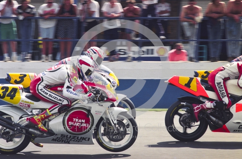 Kevin Schwantz (34), Team Lucky Strike Suzuki, and Mick Doohan (3), Rothmans Honda, Donington Park, British Grand Prix 1991.