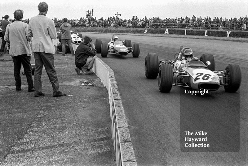 Ronnie Peterson, Vick Scandanavia Tecno 69, followed by Reine Wisell, Chevron B15, and Tetsu Ikuzawa, Lotus 59, Silverstone, British Grand Prix meeting 1969.