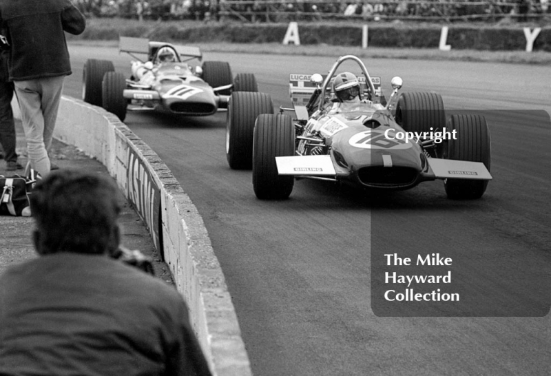 Piers Courage, Brabham Cosworth BT26A, leads Chris Amon, Ferrari 312, at Copse Corner, Silverstone, 1969 British Grand Prix.