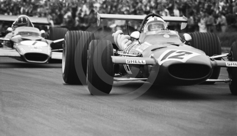 Pedro Rodriguez, Ferrari 312, and Graham Hill, Gold Leaf Team Lotus 49B, Silverstone, 1969 British Grand Prix.