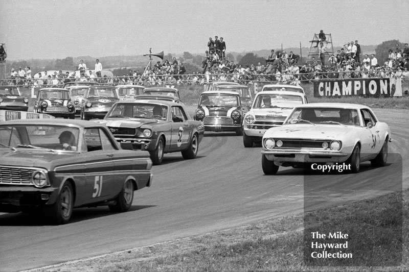 Peter Gethin, Ford Falcon, Thomas Lynch, Chevrolet Camaro; Bryan Thompson, Ford Mustang; John Miles, Ford Lotus Cortina; and John Rhodes, Cooper Car Company Mini Cooper S; Ovaltine Trophy Touring Car Race, Silverstone, British Grand Prix, 1967.
