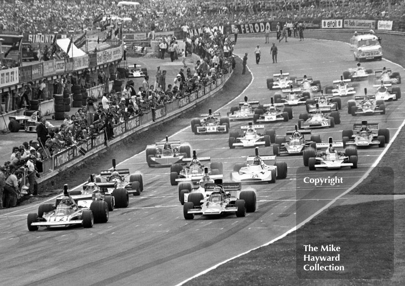 Niki Lauda, Ferrari 312B3, and Ronnie Peterson, Lotus 72, on the front row of the grid for the start of the 1974 British Grand Prix at Brands Hatch.