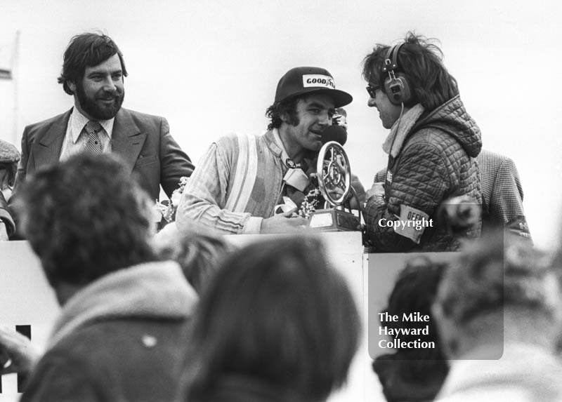Brian Henton, Boxer PR2 Hart, receives the Jochen Rindt Memorial Trophy at the F2 International meeting, Thruxton, 1977.