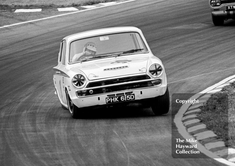 Barry Pearson, Lotus Cortina, reg no PHK 615D, at South Bank Bend, British Saloon Car Championship race, 1968 Grand Prix meeting, Brands Hatch.
