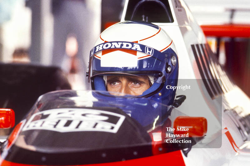Alain Prost in the pits, McLaren MP4/5, Honda V10, during practice for the British Grand Prix, Silverstone, 1987.
