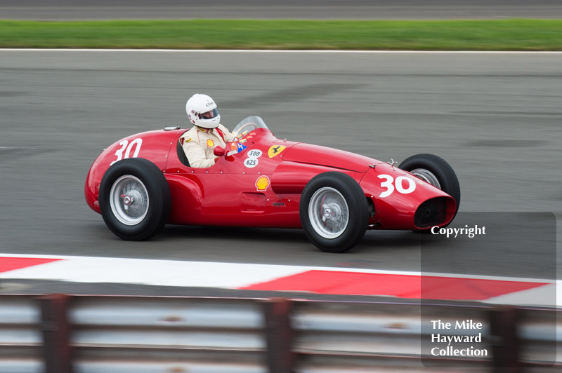 Alexander Boswell, 1952 Ferrari 625A, at Woodcote Corner during the HGPCA event for front engine GP cars at 2010 Silverstone Classic