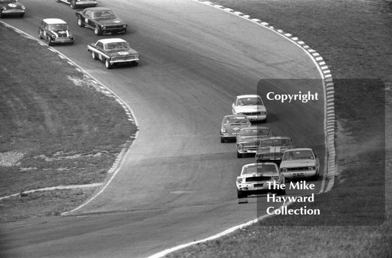 Jack Oliver, Ford Mustang, leads Graham Hill, Team Lotus Ford Cortina, on the first lap at Paddock Bend, British Touring Car Championship Race, Guards International meeting, Brands Hatch 1967.
