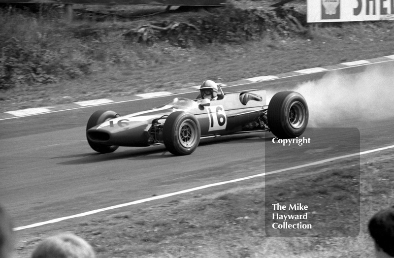 John Surtees, Lola T100 Ford, lays a smoke trail due to oil loss in heat 2, Guards European F2 Championship, Brands Hatch, 1967.