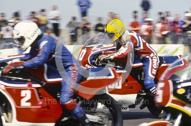 Joey Dunlop, Honda, leaves the grid just behind Ron Haslam, also riding a Honda, at Donington Park, April 1982.
