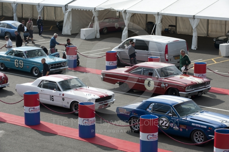 Neil Cunningham, Ford Mustang, Simon Miller, Ford Mustang, Roger Wills, Mercury Comet Cyclone, and David Franklin, Ford Galaxie, in the paddock before practice for the HSCC Big Engine Touring race, Silverstone Classic, 2010