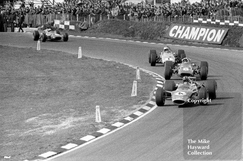 Graham Hill, Lotus 49, leads Chris Amon, Ferrari 312, Denny Hulme, McLaren M7A and Jacky Ickx, Ferrari 312, Brands Hatch, 1968 Race of Champions.