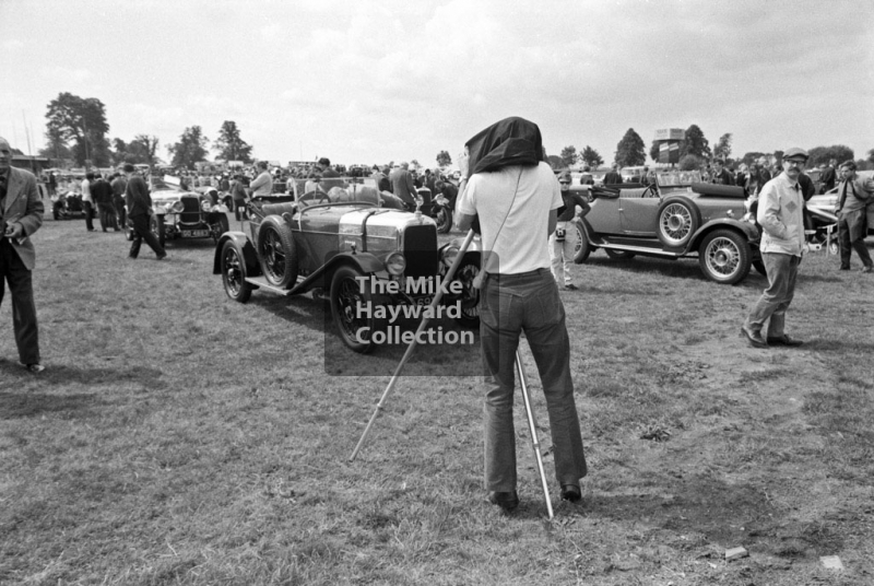 Photographer in the paddock, 1969 VSCC Richard Seaman Trophies meeting, Oulton Park.