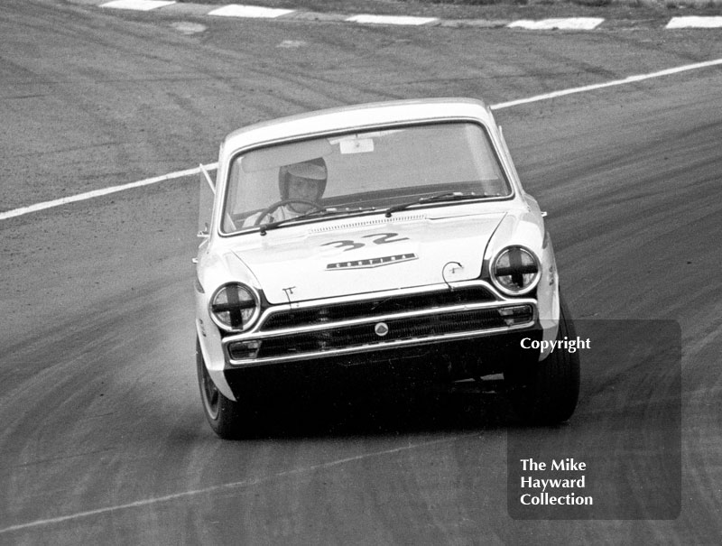 Tony Dean, Lotus Cortina, at South Bank Bend, British Saloon Car Championship race, 1968 Grand Prix meeting, Brands Hatch.