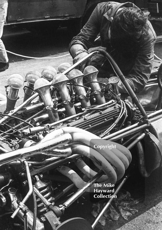 Mechanic at work on a Formula One Repco Brabham engine in the paddock, Brands Hatch, 1968 British Grand Prix.