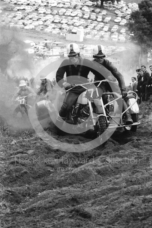 Sidecars kick up dust on the hill, 1966 motocross meeting, Hawkstone.