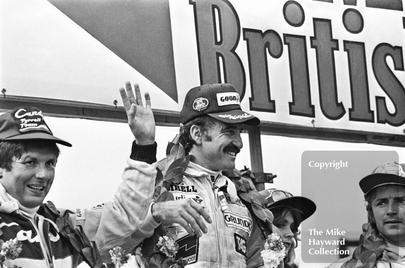 Jean-Pierre Jarier, Tyrrell, Clay Regazzoni, Williams, and Rene Arnoux, Renault, on the podium at the Silverstone 1979 British Grand Prix.