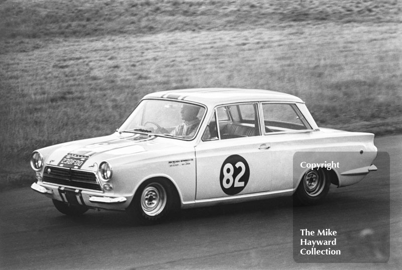 Bob Olthoff in a John Willment Lotus Cortina, 230 F00, at Nickerbrook, Oulton Park, Gold Cup meeting 1964.