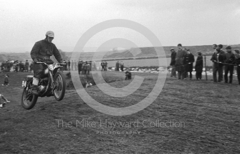 Airborne rider, motorcycle scramble at Spout Farm, Malinslee, Telford, Shropshire between 1962-1965