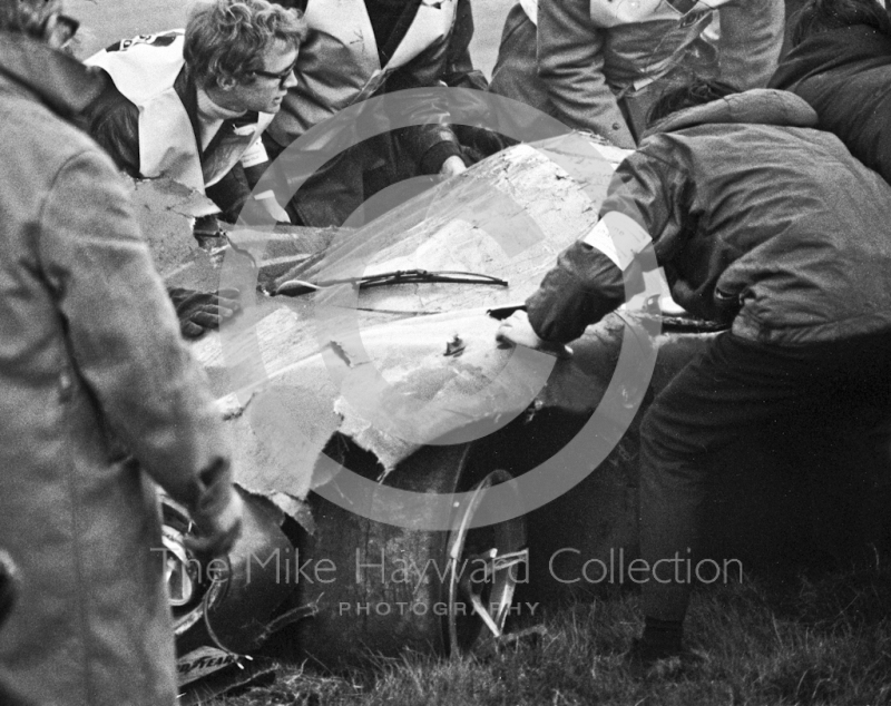 Marshalls with the wreckage of Jo Bonnier's Lola T70 which somersaulted at Bottom Bend, Brands Hatch, BOAC 500 1969.