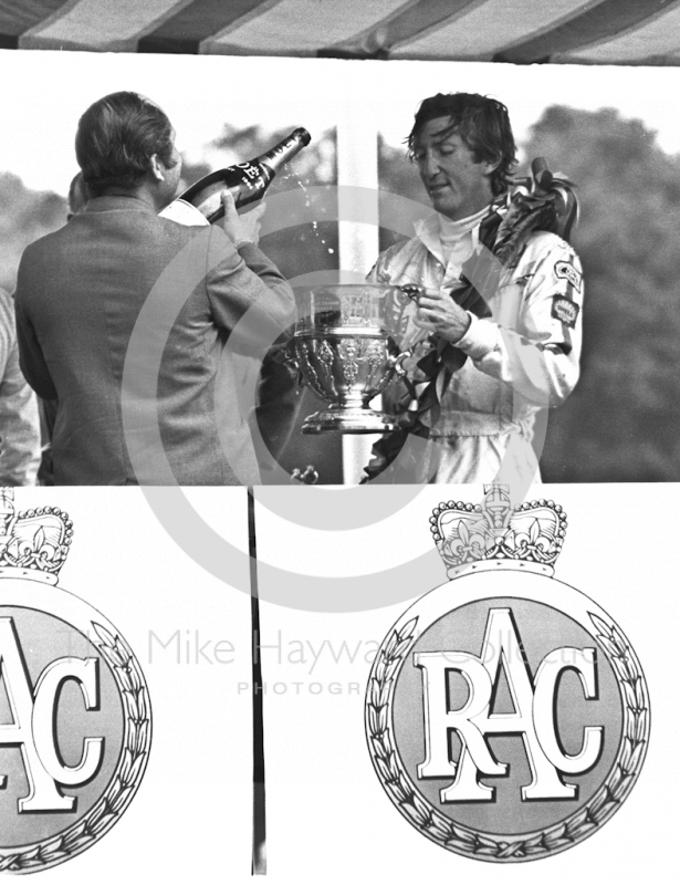 Jochen Rindt receives the winner's trophy with a cheque for £1,930. 10s, British Grand Prix, Brands Hatch, 1970