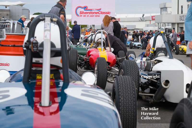 Formula Junior cars lined up in the paddock for the 2016 Silverstone Classic.