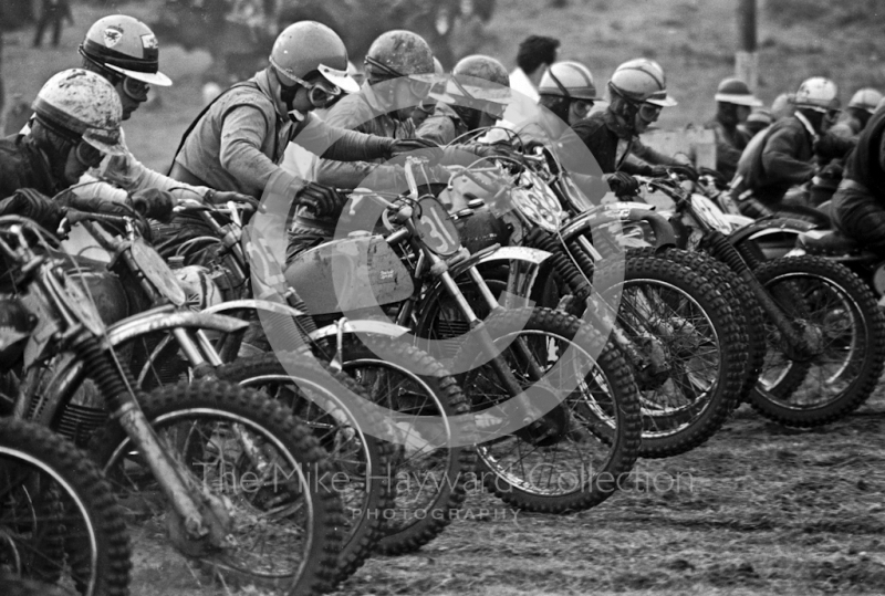 G Holt, BSA 441, and R Wilson, Husqvarna 360, in the centre of a line-up for the start of a solo race, ACU British Scramble Sidecar Drivers Championship meeting, Hawkstone Park, 1969.