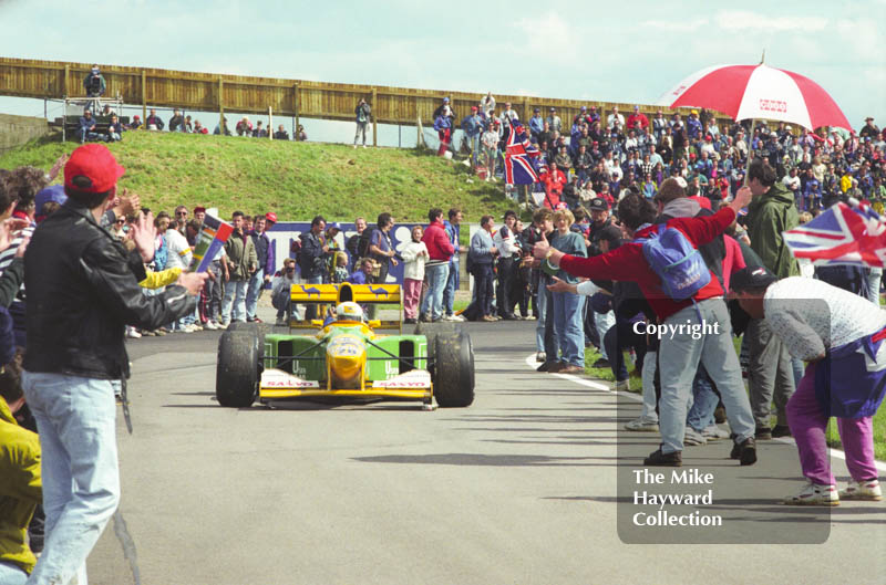 Martin Brundle, Benetton B192, negotiates the crowds after finishing 3rd, 1992 British Grand Prix, Silverstone.