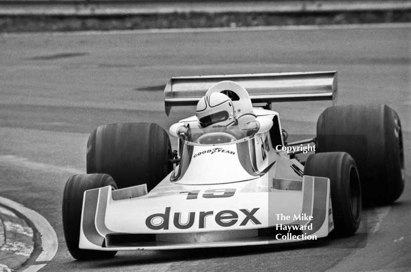 Alan Jones at Druids Hairpin with the Durex Surtees TS19 on the way to second place, Race of Champions, Brands Hatch, 1976.