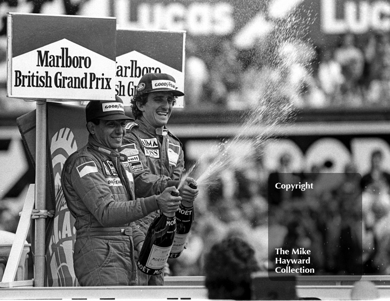Winner Alain Prost and second-placed Michele Alboreto on the podium, British Grand Prix, Silverstone, 1985