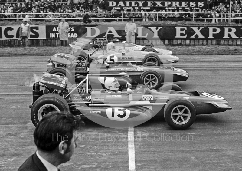 Chris Amon, works March Ford 701; Jackie Stewart, Tyrrell March Ford 701; Denny Hulme, McLaren Ford M14A; and Peter Gethin, Sid Taylor McLaren M10B Chevrolet; Silverstone International Trophy 1970.