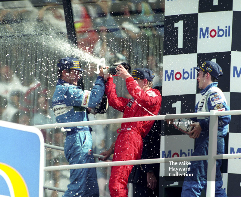 Jacques Villeneuve, Gerhard Berger and Mika Hakkinen on the podium, Silverstone, British Grand Prix 1996.