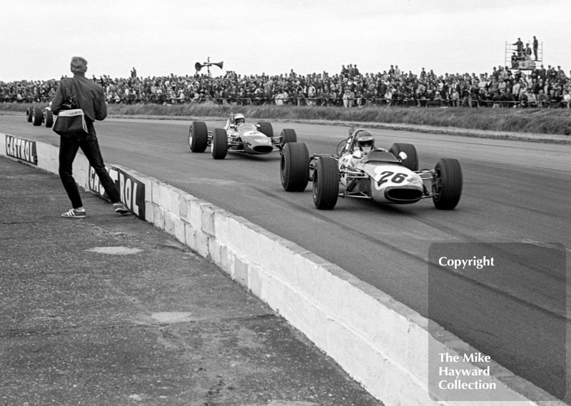 Ronnie Peterson, Tecno 69, followed by Reine Wisell, Chevron B15, Silversotne, 1969 British Grand Prix meeting.