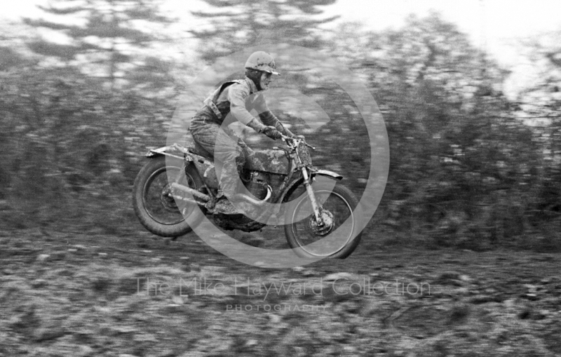 Rider takes off, Hatherton Hall Farm motocross, Nantwich, 1967