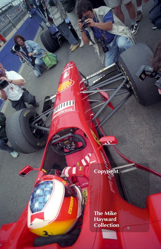 Michael Schumacher, Ferrari F310 in the pit lane, Silverstone, British Grand Prix 1996.
